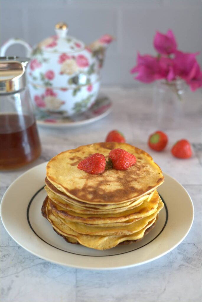 a stack of pancakes with berries