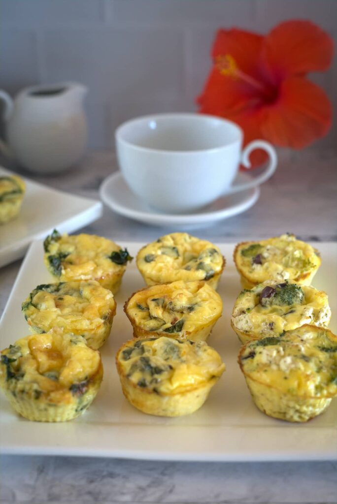 egg muffins with 3 different fillings on a plate.