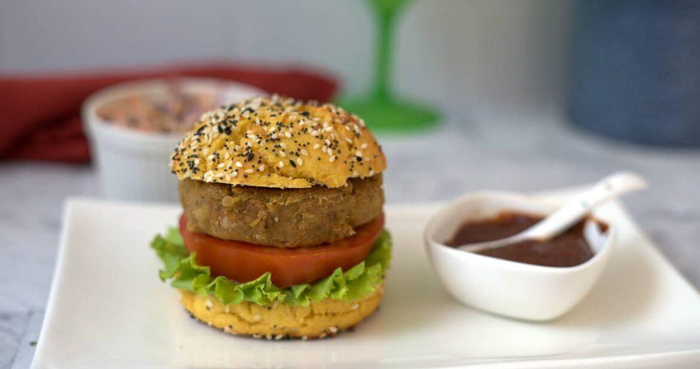 eggplant burger in bun on a plate