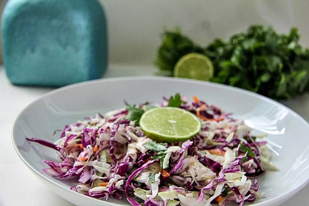 coleslaw with lime and cilantro in a bowl